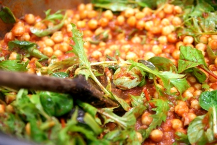 Saudi baharat scented chickpeas with fresh greens: